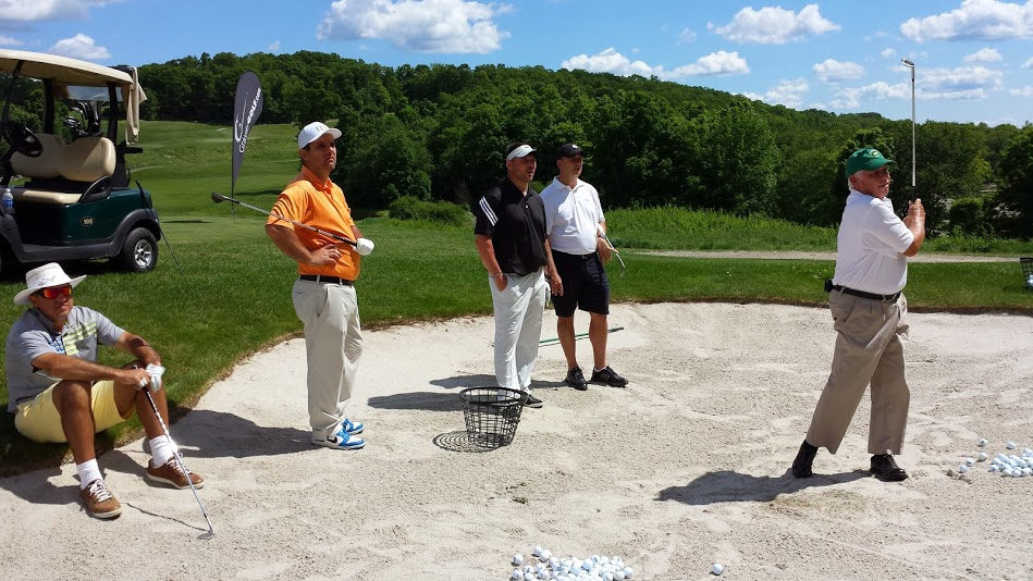 David-Lee-Giving-A-Bunker-Lesson-During-the-Gravity-Golf-School-in-New-York